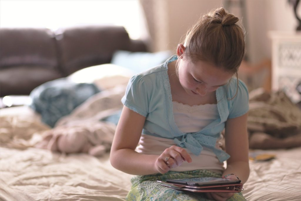 Young girl reading on a device