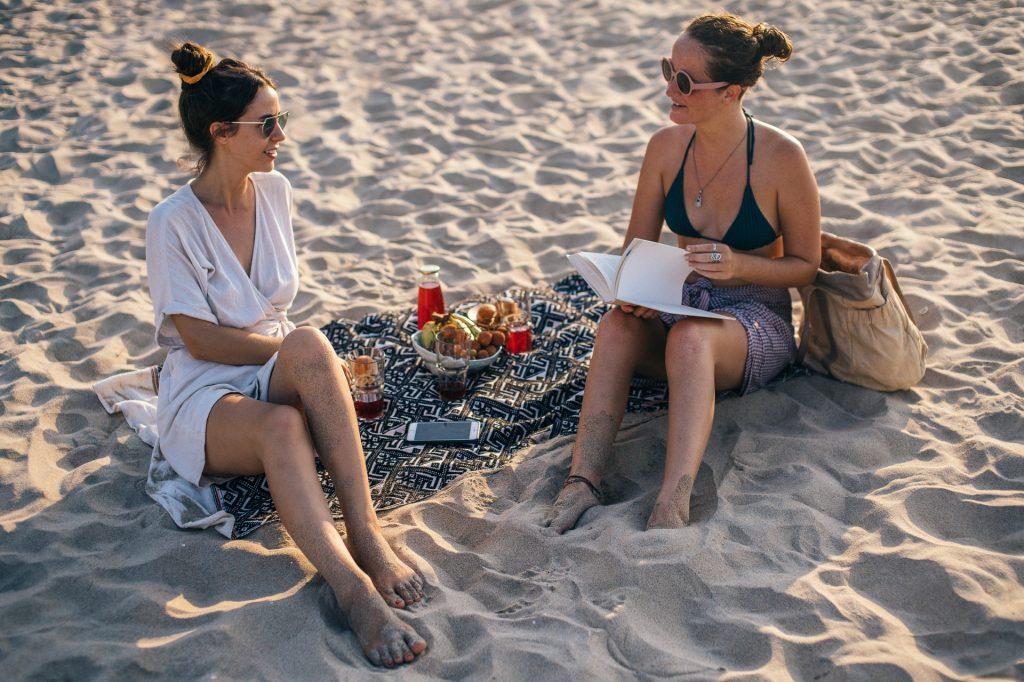 Summer Reading - Women Reading on a Beach